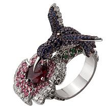 Золотое кольцо с гранатом, бриллиантами, сапфирами  и  топазами