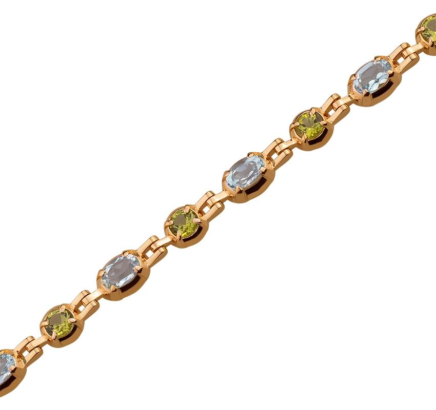 Золотий браслет з хризолітом і топазом 1б-026 фотографія 1