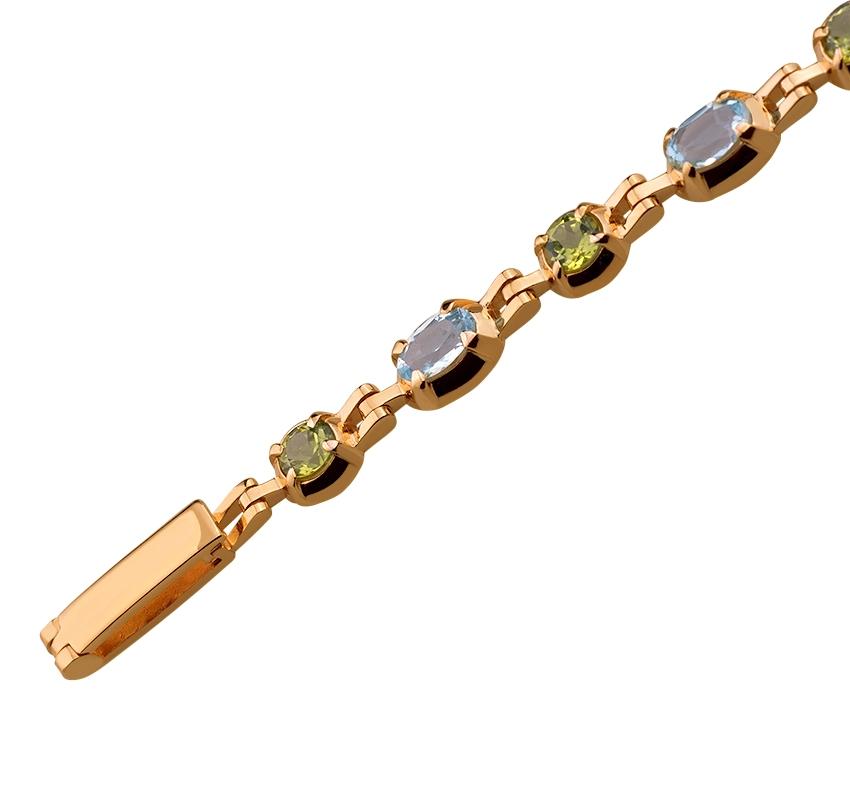 Золотий браслет з хризолітом і топазом 1б-026 фотографія 2